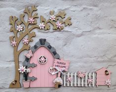A personal favourite from my Etsy shop https://www.etsy.com/uk/listing/515847288/fairy-door-with-tree-fence-and-bee-hive