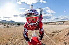 guy_performing_a_superman_seatgrab_on_motocross_bike