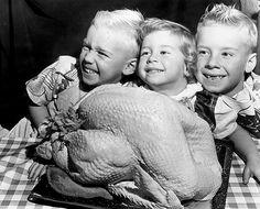 Three Boys Present Fat Thanksgiving Turkey to Mom