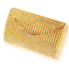An eighteen karat bi-colored gold and diamond purse