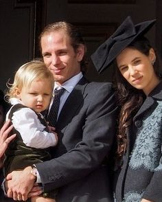 (L to R) Sacha Casiraghi with his parents Andrea Casiraghi and Tatiana Santo Domingo at the balcony parade during the Monaco National day 2014 in Monaco.