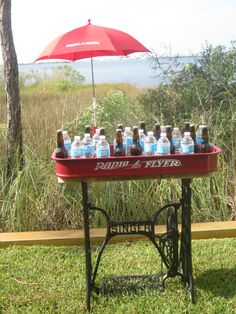 Vintage Party Bar - Singer Sewing Machine on the bottom and Red Flyer Wagon & matching Red Flyer Umbrella on top.  Roll out the beverages and let the party begin.  Great as a display holder at Christmas time. www.coolcottage.net  or  www.coolchairs.net