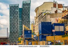 REEPERBAHN HAMBURG, GERMANY - April 20, 2014: Dancing Towers and  Modern architecture Dancing Towers, famous Esso gas station and buildings during demolition in St. Pauli