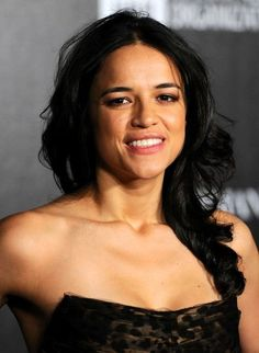 Michelle Rodriguez Side Sweep - Michelle Rodriguez topped off her look with a sweet side sweep when she attended the Haiti Carnival in Cannes.