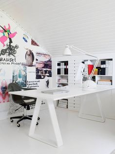 attic office space with beadboard walls and ceiling