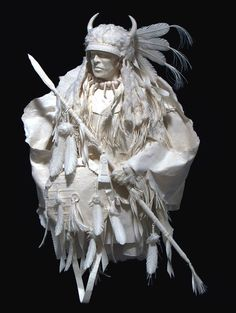Paper Art of Native American Indians made by Allen and Patty Eckman. The detail on their creations are incredible! Their website explains the process.