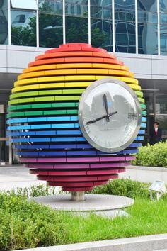 Rainbow colored clock sculpture