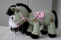 Pony with saddle and bridle