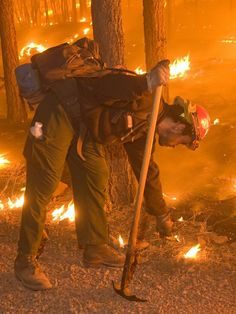 A firefighter sets a backfire at night to stop the 511,000-acre Wallow Fire