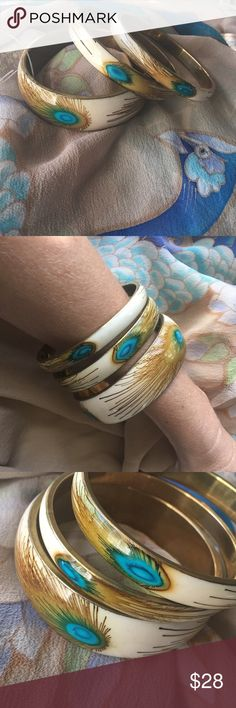 🆕Peacock Bangle Bracelet Set 🆕Be proud as a peacock when wearing your new Peacock Bangle bracelets. This lovely set of three gold/brass tone bracelets in cream + brown/gold + Turquoise hues will pair well with many items, especially my Peacock kimono (available in separate listing). Make an offer or ask me to create a custom bundle for the best discount! 😘💗🐺 Jewelry Bracelets