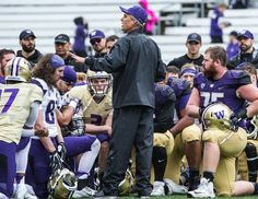 Washington coach Chris Petersen gathers his team around him following Saturday's spring game at Husky Stadium. The Washington Huskies held their spring game at Husky Stadium Saturday, April 22, 2017. (Dean Rutz/The Seattle Times)