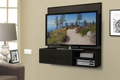 "This wall-mounted media cabinet takes a new approach to the ""entertainment center."" It hangs on the wall, allowing you to mount your TV to it, and then keep small media components on the shelves below. Wires hide behind the back panel. The cabinet is designed to hold a at TV as large as 50"