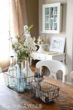 The 36th AVENUE | Dining Room Reveal and Design Tips | The 36th AVENUE - love the wire basket with bottle for center piece for kitchen table!