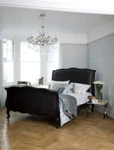 French bedroom fashion - I like this because it features the black bed but still feels light and airy and peaceful and beautiful.