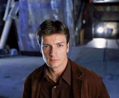 one way younger Nathan Fillion as Mal in Serenity  Photo Courtesy 20th Century Fox