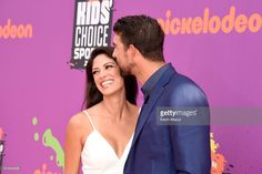 Model-Miss California USA 2010 Nicole Johnson (L) and honoree Michael Phelps attend Nickelodeon Kids' Choice Sports Awards 2017 at Pauley Pavilion on July 13, 2017 in Los Angeles, California.
