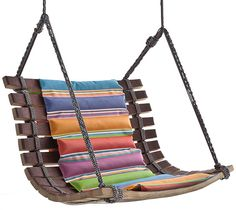 Angela Missoni's Miss Dondola. A beautiful mix of colorful padding and playful string connecting the wood staves of the casks to form what looks like a fun swinging chair.