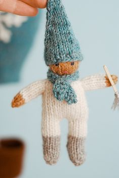 DIY Jack Frost - Cute little knitted doll. Free pattern. They call the doll Jack Frost and he comes with a pattern for a hot-air balloon. But he looks like a gnome to me. Just change the colors, take away the scarf and add a beard!