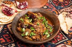 For the best stews, use lamb shanks simmered slowly on the bone Here, Moroccan seasonings mingle for a bright balance of flavors: sweetness comes from dates and onions, and heat and spice from ginger and cumin This tagine is traditionally accompanied only by warm whole wheat pita or Arab flatbread