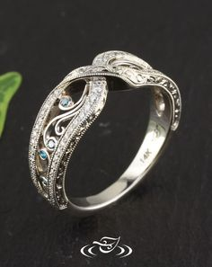 Amzing antique style wedding band with cross over and delicate filigree.