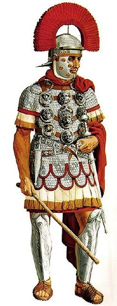 A centurion of the mid-1 st century CE wearing his decorations (phalerae) on a harness over a scale shirt. He also wears greaves and a transverse crested helmet as a sign of his rank. Artwork by Peter Connolly