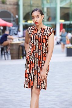 Beautiful flattering Ankara dress with front zip closure. Tailored to gently flow over your figure. Perfect for office wear or a night out. Full Length: 40 inches Colour - Orange and brown MODEL: size 8 Size co African Fashion Ankara, African Inspired Fashion, Latest African Fashion Dresses, African Print Fashion, Africa Fashion, African Women Fashion, African Style, Fashion Women, Short African Dresses