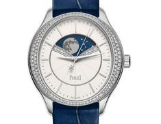 The @piaget Limelight Stella Astronomical Moon Phase watch is shown here in white gold with diamonds on a blue strap.  Read more @ http://www.watchtime.com/wristwatch-industry-news/watches/piaget-offers-ladies-the-moon-with-limelight-stella-astronomical-moon-phase/ #piaget #watchtime #wristcandy #ladieswatches #SIHH2016