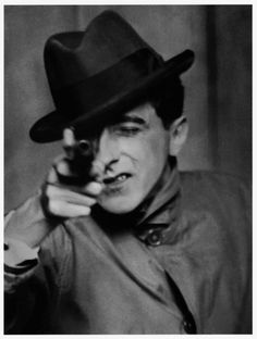 berenice abbott, ca. 1926, jean cocteau with gun ---   berenice abbott left the united states in 1921 to study sculpture in paris, where she was hired by man ray in 1923 to be his assistant. she took to photography immediately and by 1926 had set up her own studio, where she began a successful career as a portrait photographer. #jeancocteau #bereniceabbott #blackandwhite