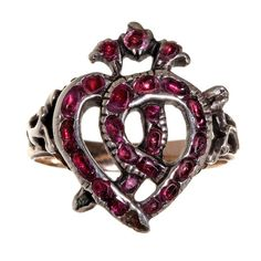 18th century Luckenbooth ring. Garnets set in silver on gold shank. The luckenbooth is a Scottish symbol for marriage. Used throughout the 16th to 18th century as a love token.