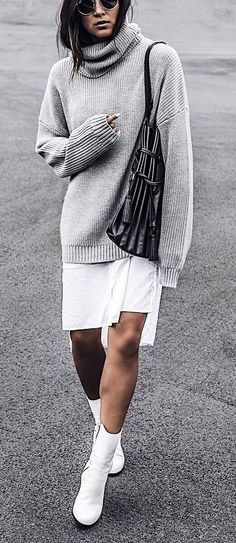winter outfit idea : oversized sweater   bag   white skirt   boots