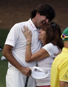 Bubba Watson hugs his mother Mollie after winning the Masters golf tournament following a sudden death playoff on the 10th hole Sunday, April 8, 2012, in Augusta, Ga. (AP Photo/Matt Slocum)