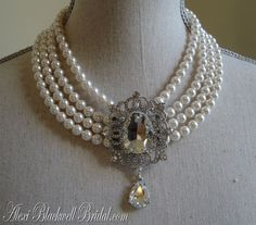 White pearl choker with crystal focal