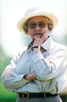 Queen Elizabeth II, looking pensive, in the Royal Box as she watches a polo match at Smith's Lawn Polo Field on the Windsor estate, Berkshire, England, Great Britain, June 1982.