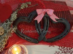 Twisted Hearts handmade with  horseshoes, hot forged at heart on Etsy, $50.84