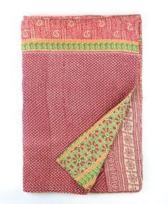 Present ideas: special kantha throw quilt with elaborate paisley design lining the borders