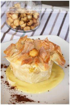 Coccole alla Panna: Cestini di pasta fillo con mele e nocciole su crema pasticcera al rosmarino