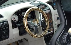 STRANGE AUTO ACCESSORIES - CUSTOM GOLD STEERING WHEEL - TWO 45 CALIBER AUTOMATICS FORM THE INSIDES - IF YOU HONK THE HORN WHAT HAPPENS?