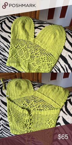 Hand made crocheted top from Brazil This is a beautiful hand made crocheted top made to order from Brazil.  Worn twice, but unfortunately I can't fit the top portion anymore.  It is not see thru in the cups but unlined. It is a sizzling, very SEXY top! My Bikini Brazil Tops Camisoles