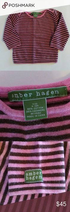 Amber Hagen Cashmere Baby Girls Sweater This soft and adorable little sweater is by Amber Hagen Cashmere and is made of an 80% cotton/20% cashmere blend knit fabric, in n a pink and brown stripe. It is in excellent used condition. Size 6-12 months. Amber Hagen Shirts & Tops Sweaters