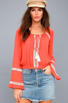 Travel back to the summer of love with the Simpler Times Coral Orange Long Sleeve Crop Top! Pierced crochet lace accents this gauzy crop top.