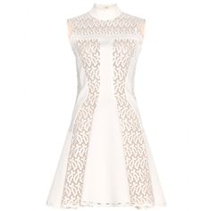 Alexander McQueen's dress will transition from day to night with a simple swap of heels. Delicate broderie anglaise and tonal panelling are cleverly constructed for a silhouette that fits and flares in all the right places. The short length is tempered by a demure, high neckline - elevate further with heels.