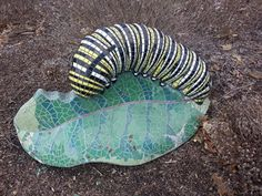 This Mosaic Caterpillar is a part of a trio of three sculptures depicting the life cycle of a butterfly in the Garden of Healing and Renewal at the Mclaren Health facility.