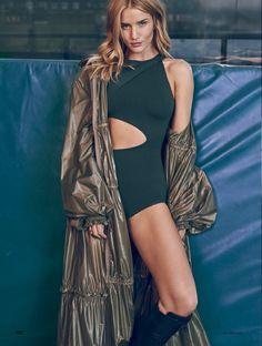 Model Rosie Huntington-Whiteley poses in Balmain bodysuit with Fenty x Puma nylon coat