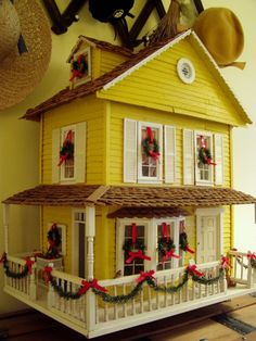 This will remind me to add wreathes and garlands to our miniature house this Christmas - so sweet!