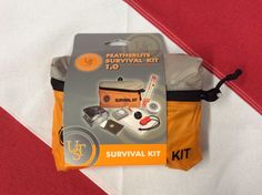Survival Kit Featherlite 1.0 emergency tactical disaster preparedness gear UST #USTBrand  FeatherLite™ Survival Kit 1.0 Contents  Button Compass 1  Emergency Blanket 1  Emergency Poncho 1  JetScream™ Micro Whistle 1  4″ See-Me™ Light Stick 1  StarFlash® Micro Mirror 1  Survival Towel 1  Waterproof Matches 1 Total Pieces 8