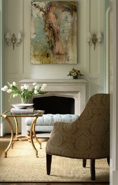 A neutral rug grounds the space and draws the eye to the intriguing artwork.