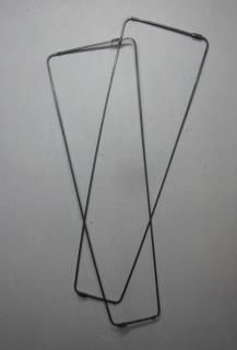 Pants stretchers - They were used to stretch the legs out so that they would dry less wrinkled and with less shrinkage and have a fold in them while drying on the line.