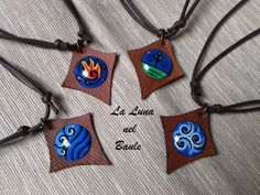I 4 elementi: terra, aria, fuoco, acqua. Ciondoli in pelle e vetro dipinto a smalto by www.facebook.com/lalunanelbaule.  #fourelements #elements #earth #air #fire #water #leather #pendant #paintedglass #pagan #lalunanelbaule #elementi #cuoio #vetrosmaltato #ciondolo #pagano #terra #aria #fuoco #acqua #handmade