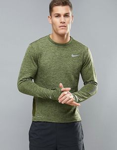 Get this Nike Running's long-sleeved t-shirt now! Click for more details. Worldwide shipping. Nike Running Therma Sphere Element Long Sleeve Top In Green 807453-331 - Green: Top by Nike, Supplier code: 807453-331, Insulating Therma Sphere fabric, Moisture-managing Dri-FIT technology, Moves sweat away from the skin, Encourages surface evaporation, Helps to keep you dry and comfortable, Thumbhole cuffs prevent sleeves from riding up, Reflective details for enhanced visibility on low-light…