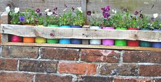 How to Make Colorful Planters from Cans in A Wooden Trough